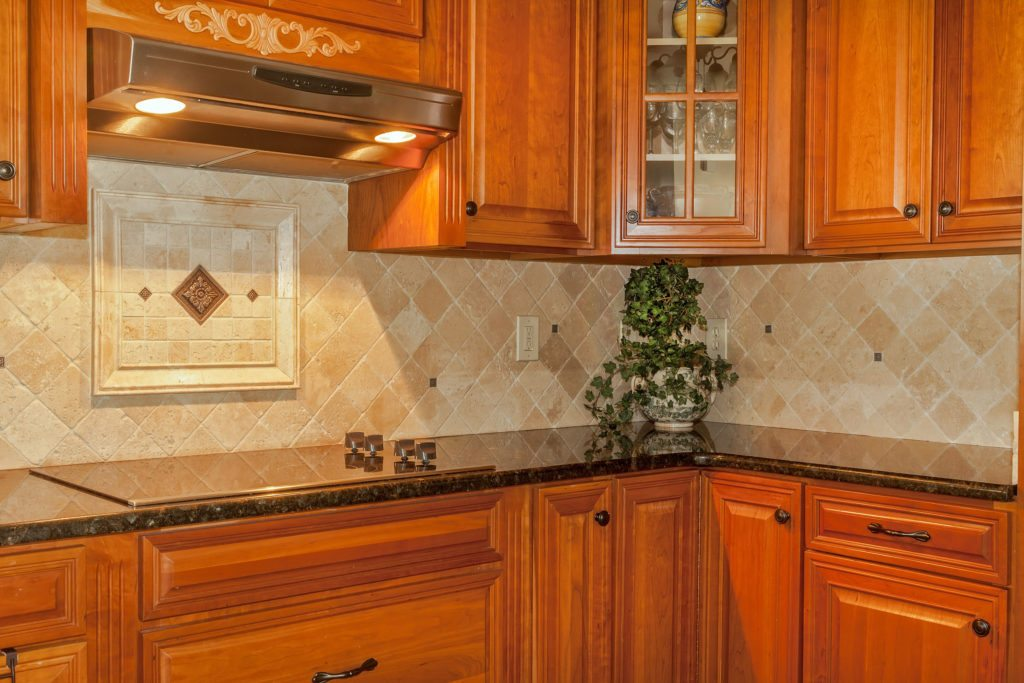 32548934 – traditional kitchen with stone backsplash and granite countertop
